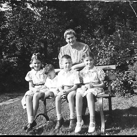 Mama Loewenhardt with her four children; L to R, Pauline 9, Joey 1, Hubert 5, Lucy 8