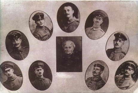Collage of nine Löwenhardt brothers in their WWI uniforms with their mother, Pauline, at the center. Herman is left of center.