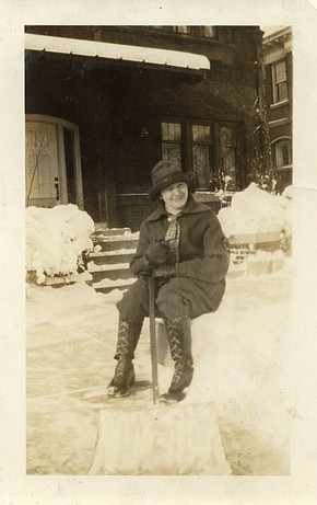 Elizabeth Ring shoveling snow from the front walk in front of the house where she worked, about 1925.