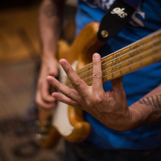 Photo Of Bassist Playing Bass Guitar
