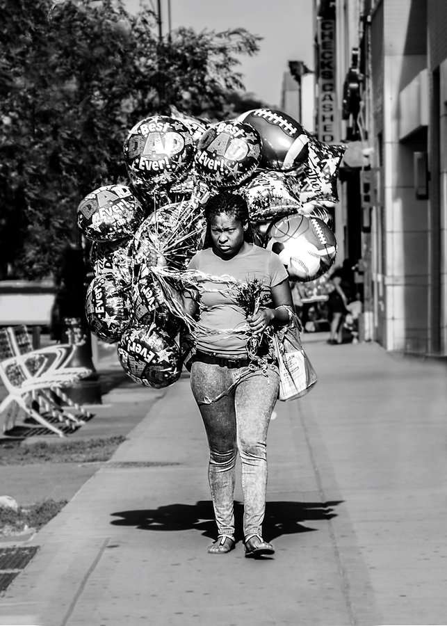 Woman carrying ballons - Fathers day - Brooklyn NY - Black and white photography