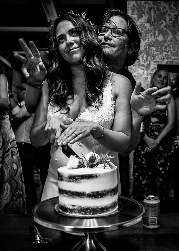 Bride and groom cutting wedding cake  - Wedding photography - Black and white photography