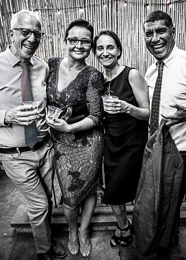 Wedding guests laughing in backyard  - Wedding photography - Black and white photography