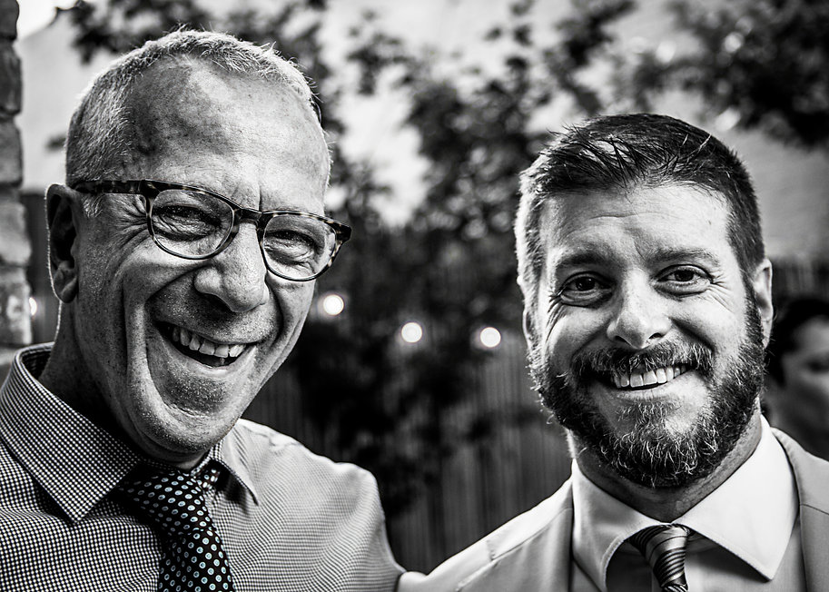 wedding guests laughing  - Wedding photography - Black and white photography