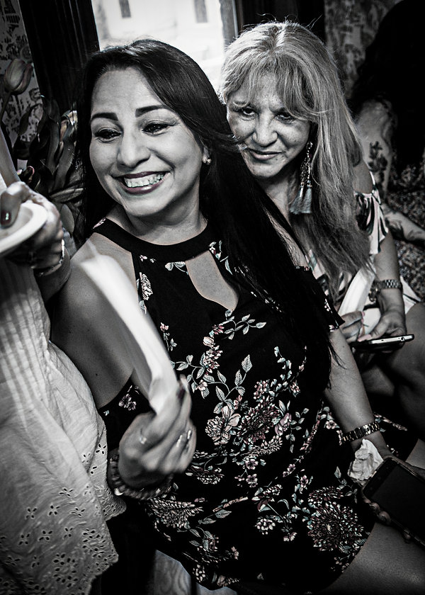 Wedding guests laughing at a wedding  - Wedding photography - Black and white photography