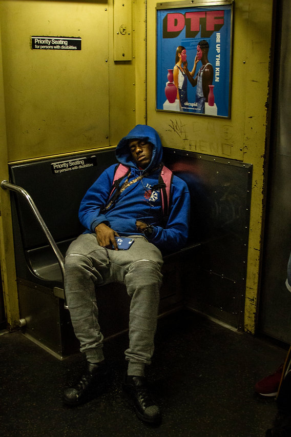 Young man sleeps in subway car in NYC - Street photography