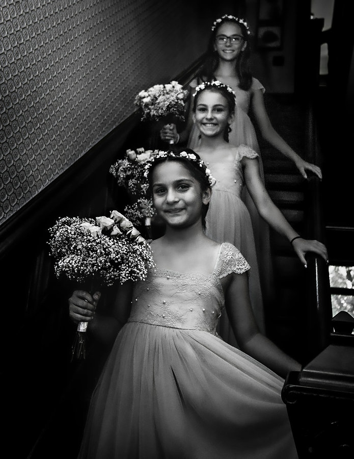 Bridesmaids smiling walking down stairs to wedding - Back yard wedding - Wedding photoraphy - Black and white photography
