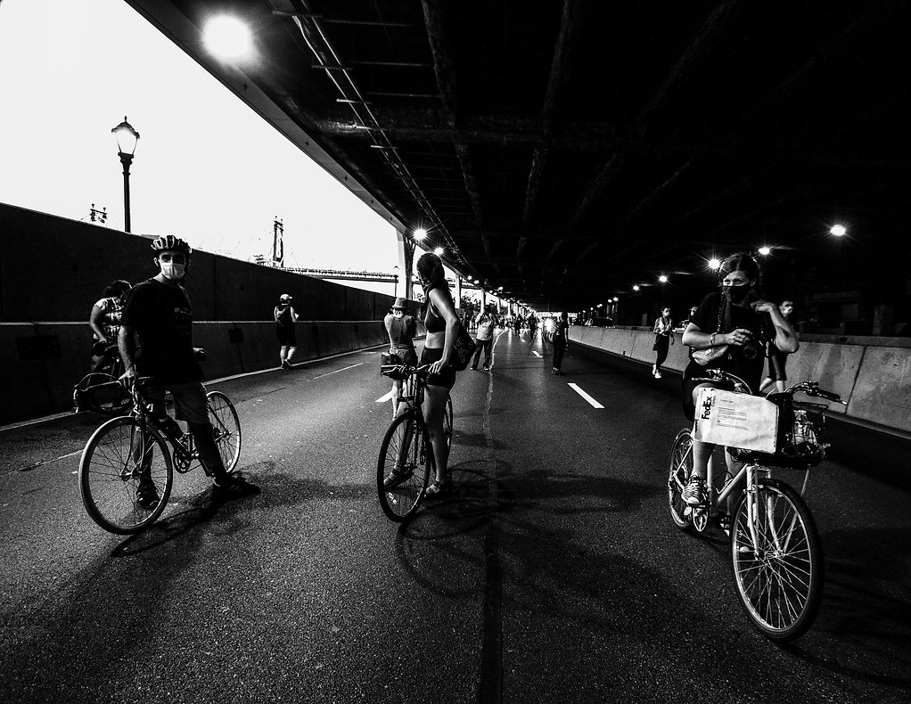 People protesting under Brooklyn Bridge - Woman eating at a restaurant wearing masks - coronavirus - Bicycle- Black and white photography
