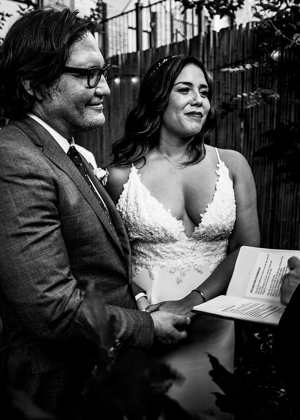 Bride and groom getting married in backyard wedding - Black and white photgraphy - Wedding photography