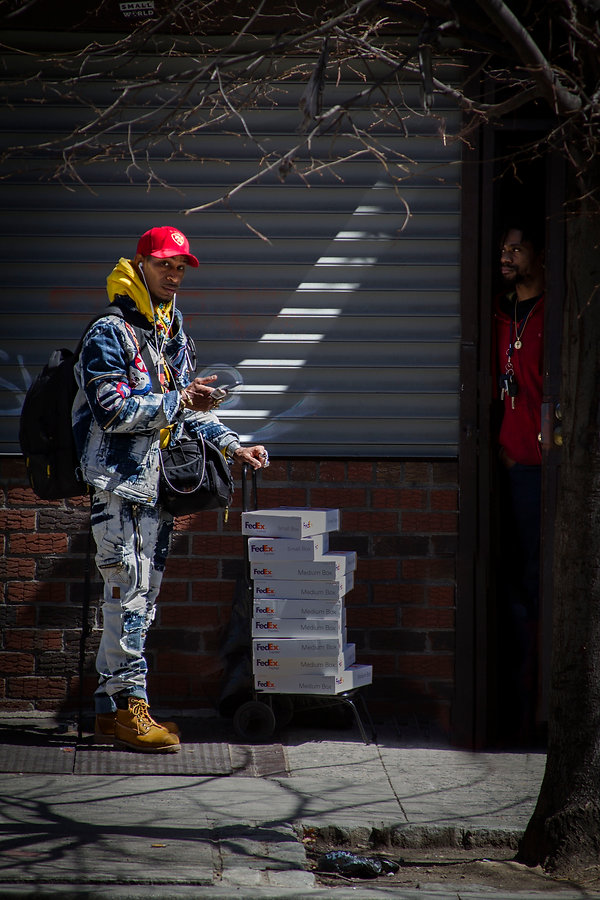 Man delivering packages - Brooklyn NY - Street photography