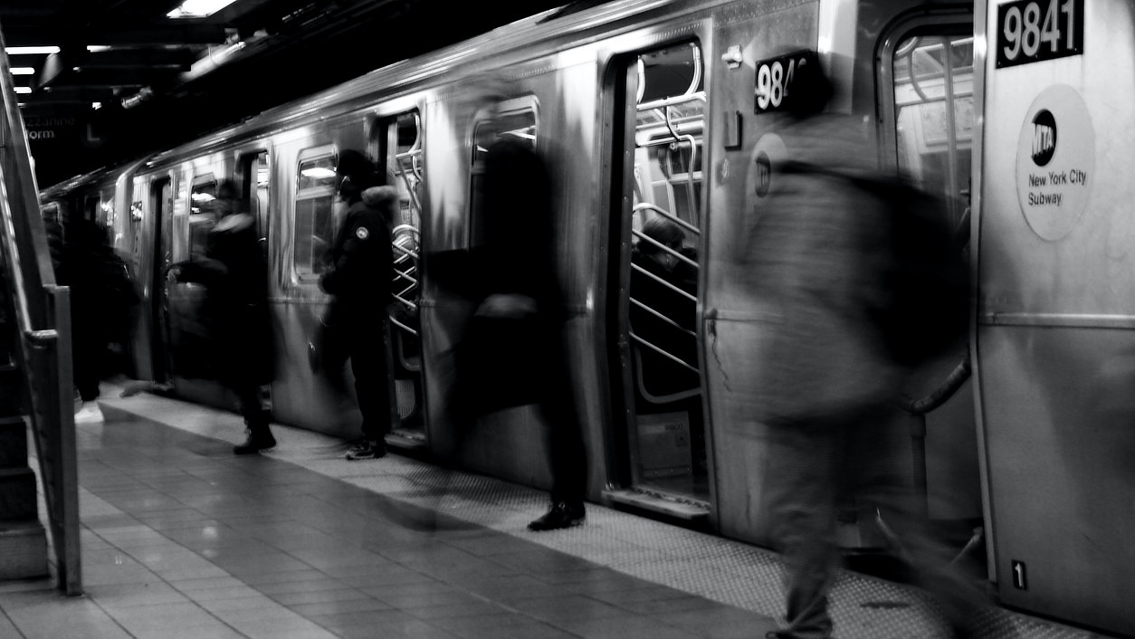People getting off a train - NYC - Black and White Photography
