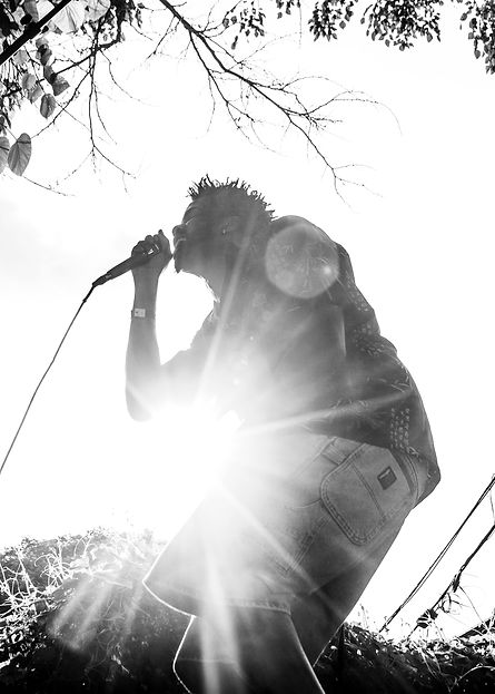 Singer at a backyard music festival in brooklyn - Blackand white photography - Light flares.