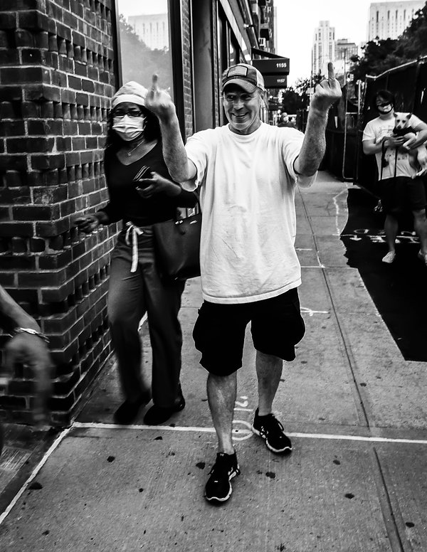 Man gives the Protesters of the Black LIves Matter March the finger - Street photography