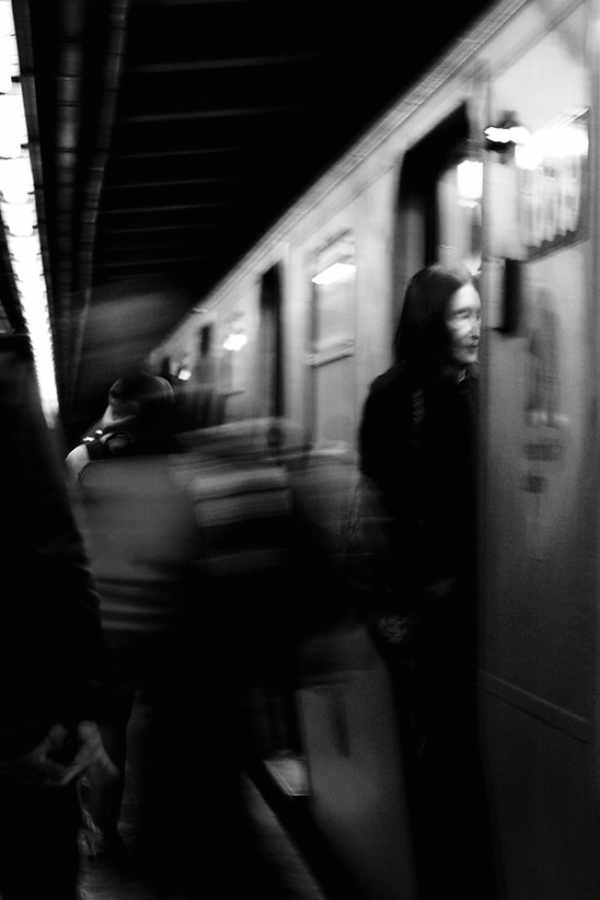A man getting on a train - NYC - Black and white photography