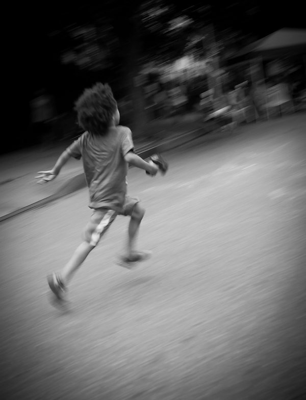 Boy running in street Brooklyn, NY, Double exposure - Black and white photography