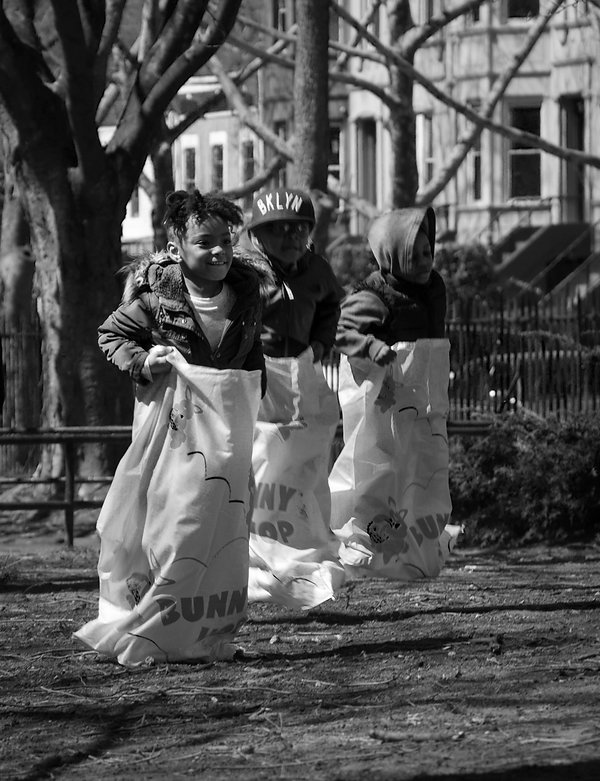 Kids in potato sack race - Jumping - Brooklyn NY - Black and white photography