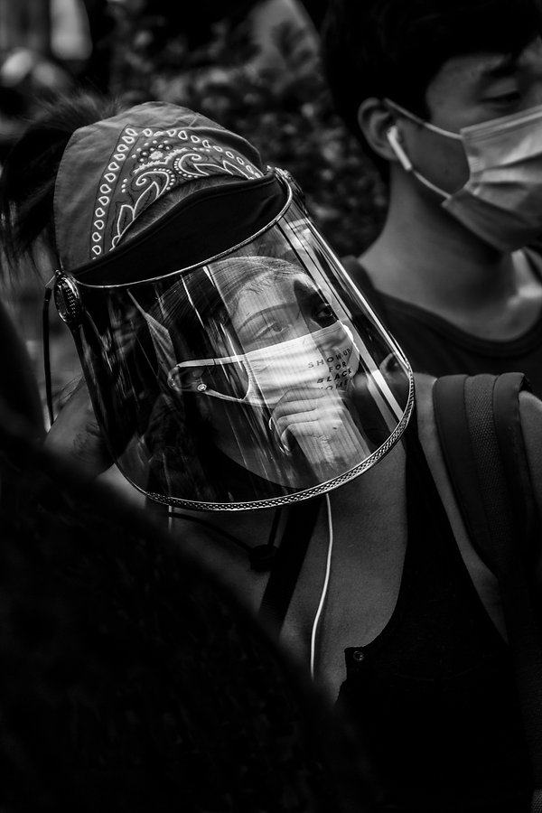 Woman wearing face guard with reflection - NYC - Protests - People protesting under Brooklyn Bridge - Woman eating at a restaurant wearing masks - coronavirus - Bicycle- Black and white photography