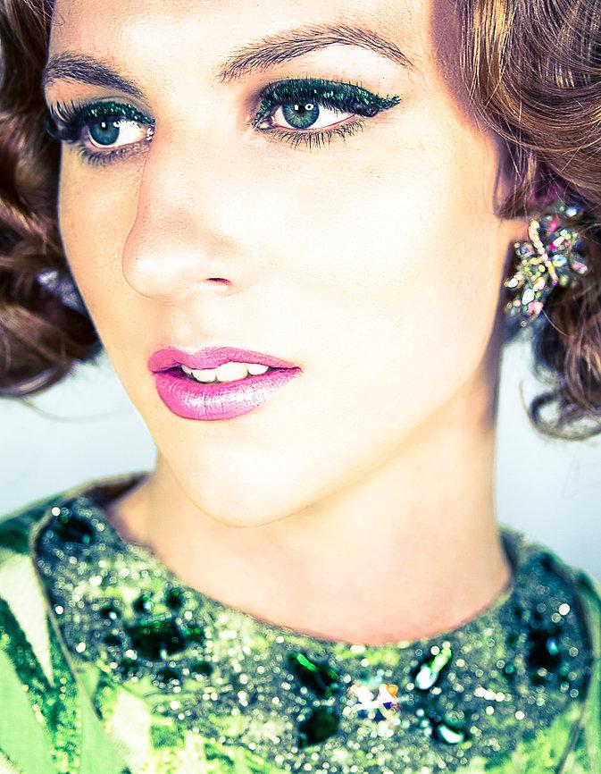 Model wearing green glitter eye makeup - Fashion photography