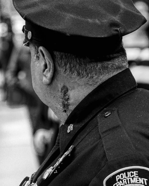 Police officer with scar on his neck - NYC protests - Srteet photography - Black and white photography
