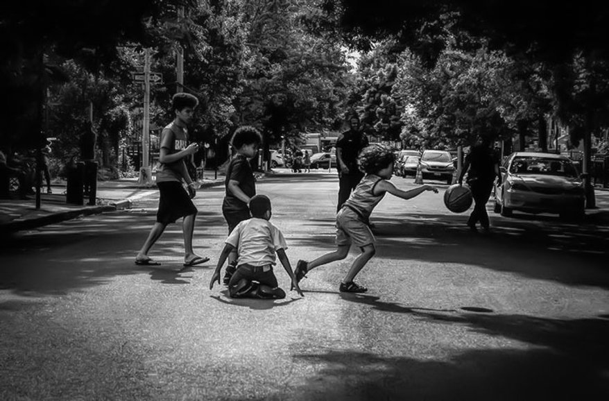 KIds playing in street of Brooklyn - Police - Black party - Black and white street photography