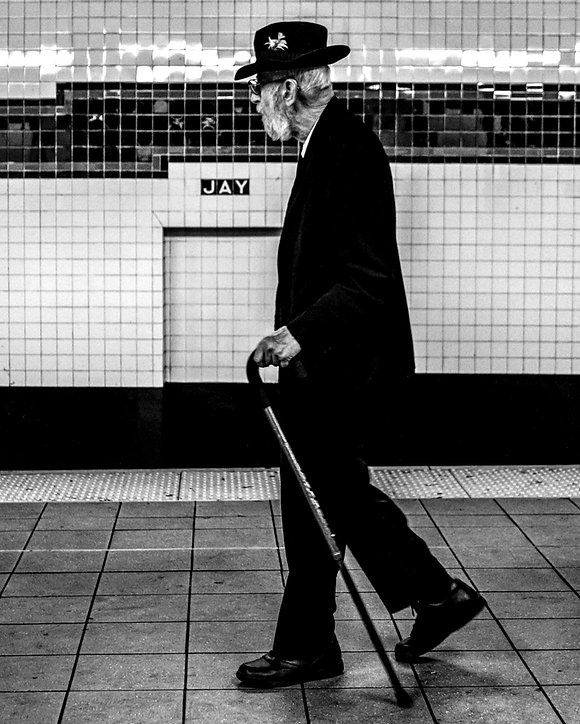 Man walks on subway platform at Jay street in NYC - black and white photography