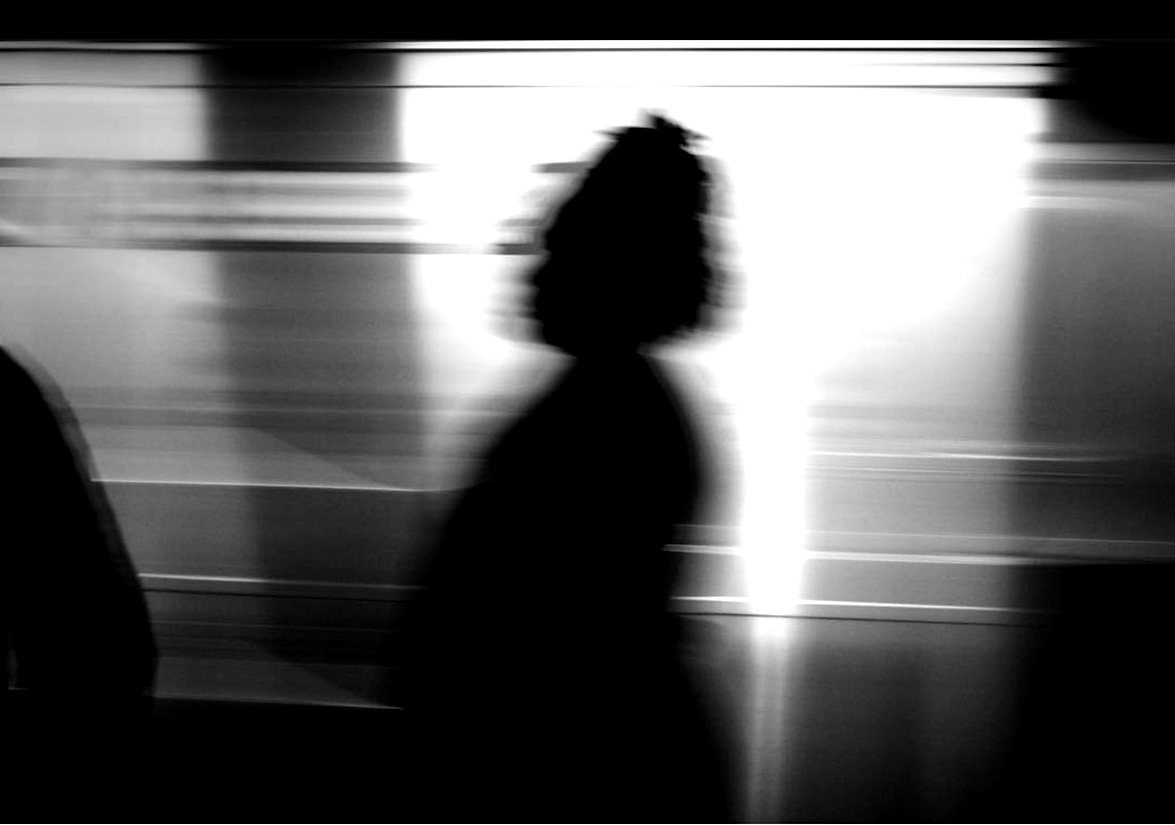 Shadow of woman against NYC subway train - Black and white street photography