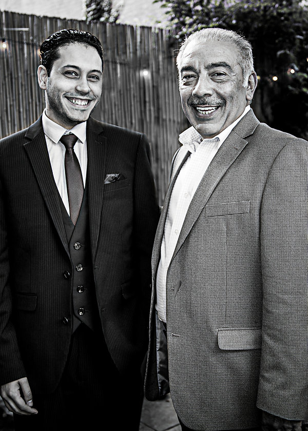 Wedding guests smiling at after party  - Wedding photography - Black and white photography