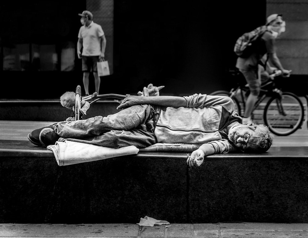 Homeless man sleeping on concrete - NY - - Black and white photography