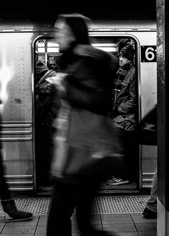 Man looks out the door of a subway - NYC - Black and white photography