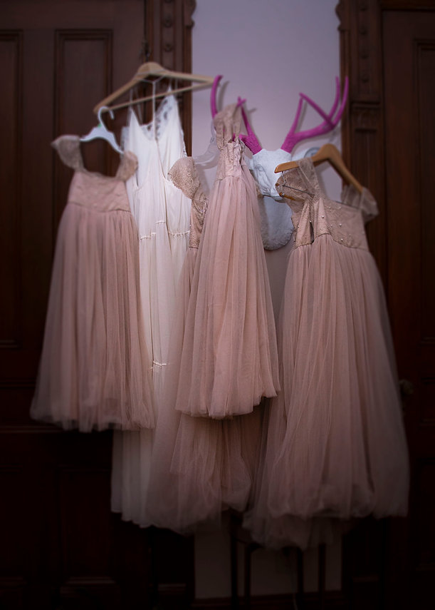 Wedding dresses hanging on door - Wedding photographer - Backyard wedding