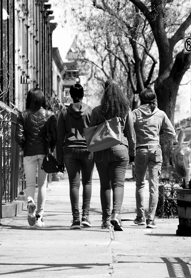 Girls strutting on street in Brooklyn, NY - Black and white photography