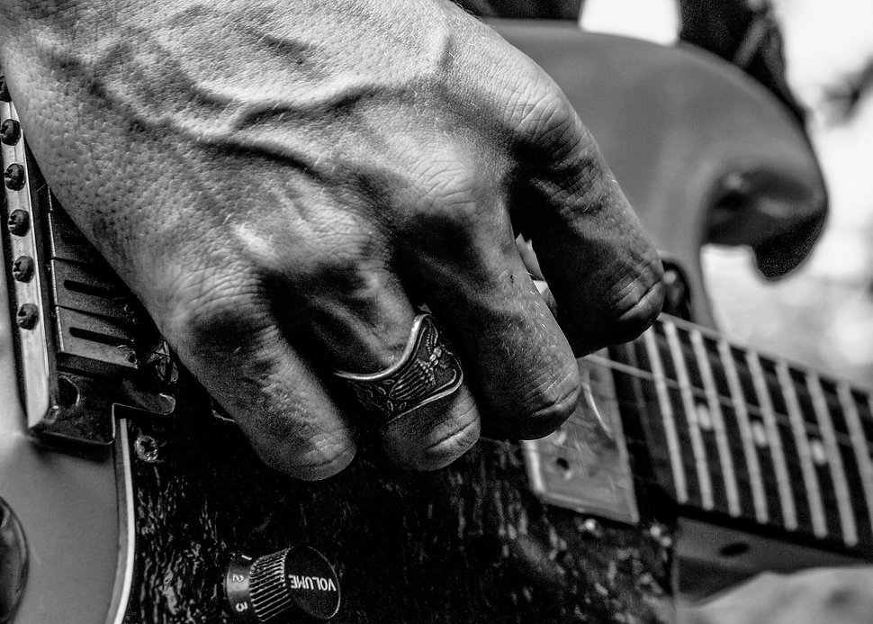 Hand strumming guitar - Music - Blackand white photographt