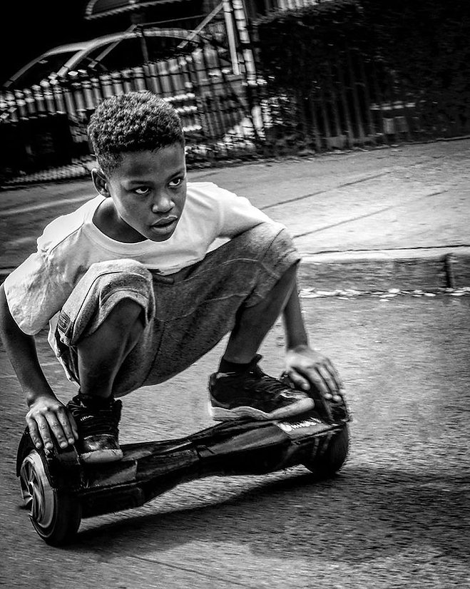 Boy riding a hoverboard in Brooklyn, Ny - Black and white photography