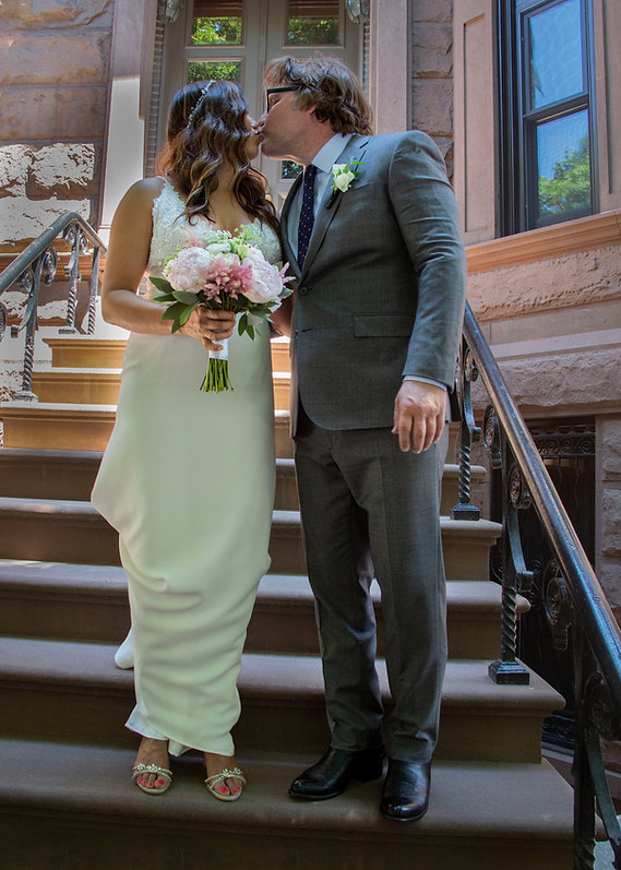 Bride and groom kissing on stoop - Backyard wedding - Wedding photographer