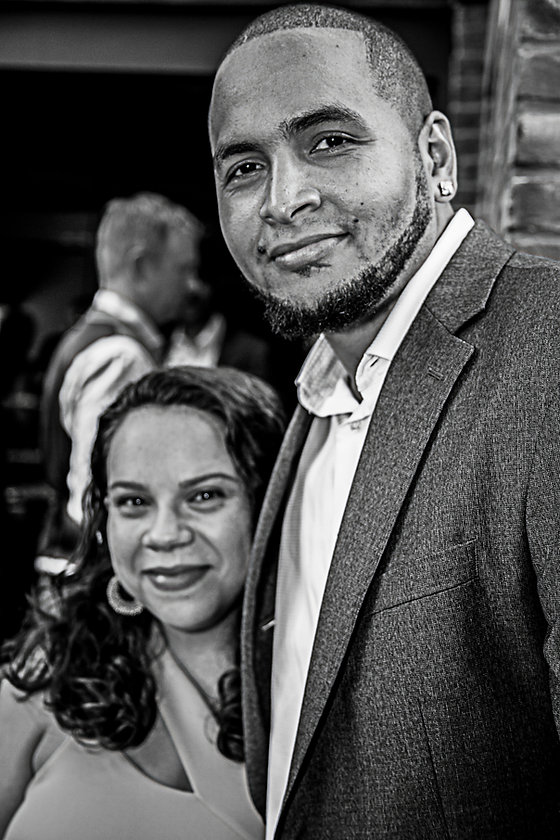 Wedding guests smiling at wedding party  - Wedding photography - Black and white photography