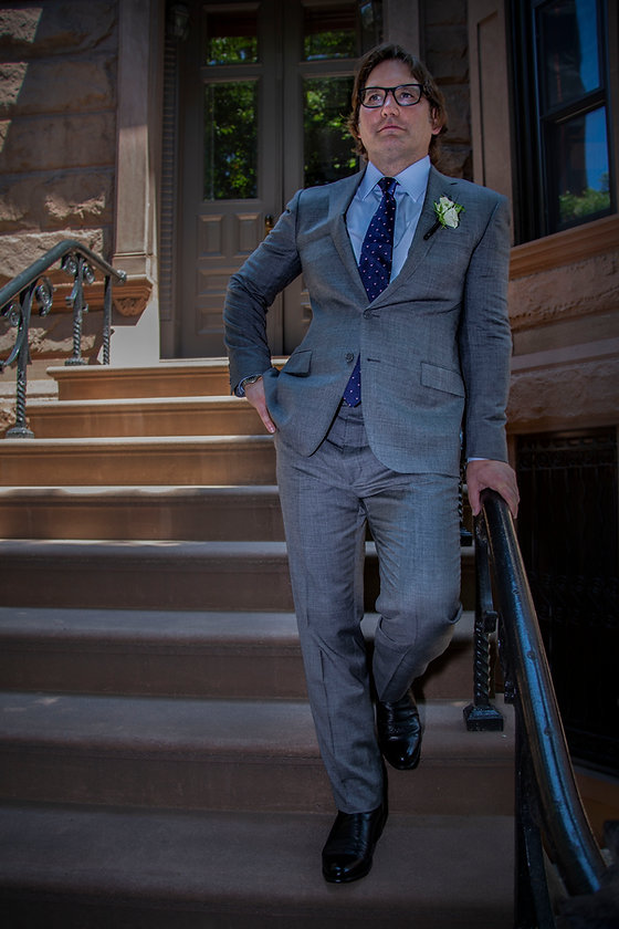 Groom standing on Brooklyn stoop waiting for his bride - Backyard wedding - Wedding photographer