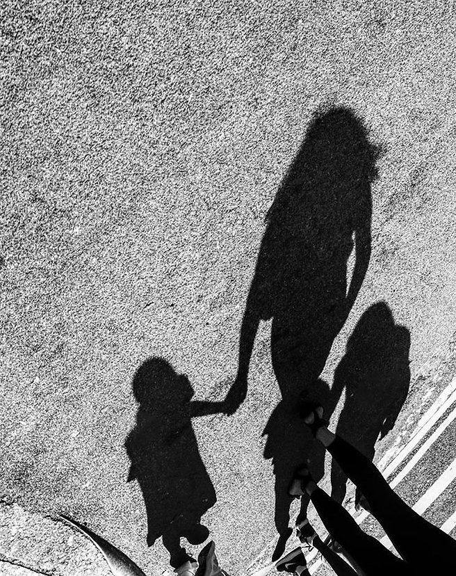 Shadow of a mother and her children on a crosswalk - NY - Black and white photography