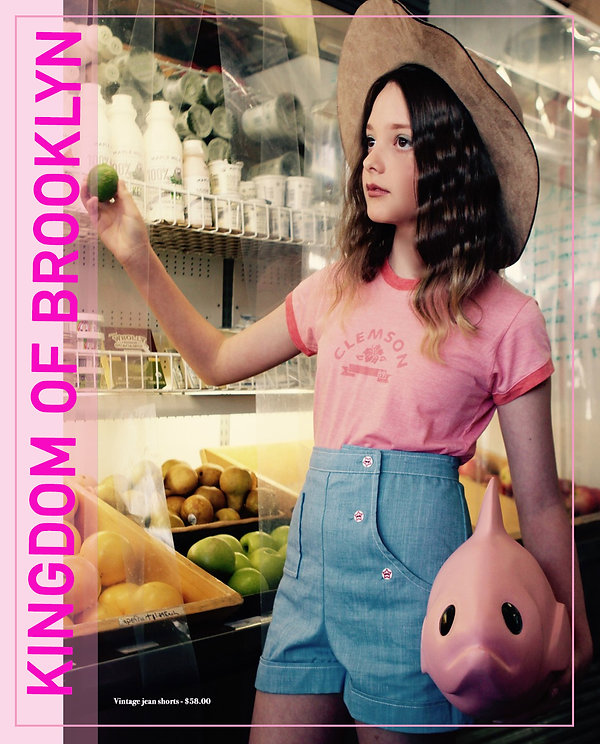 Young girl at fruit section of supermarket holding a lime - Fashion photography - NYC