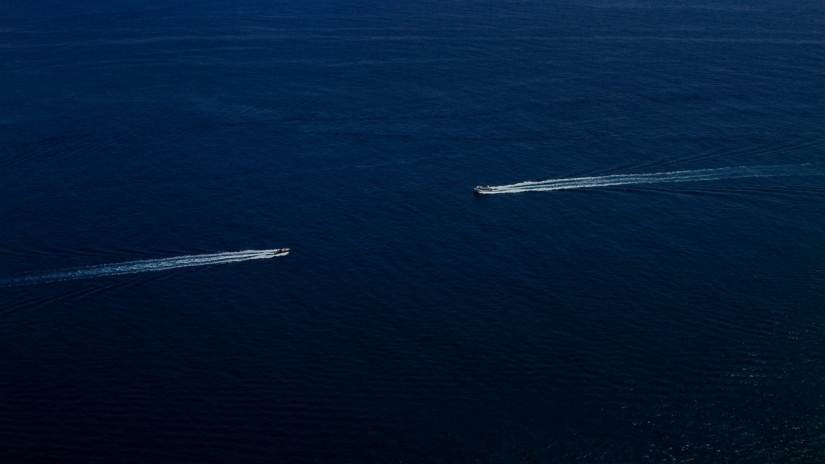 Two boats heading towards eah other in the ocean - Amalfi Coast - Italy
