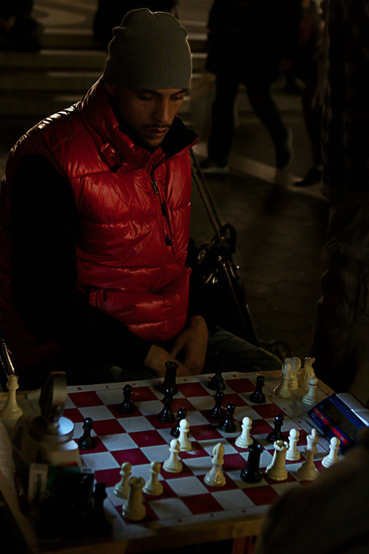 Man playing chess in NYC - - Street photography