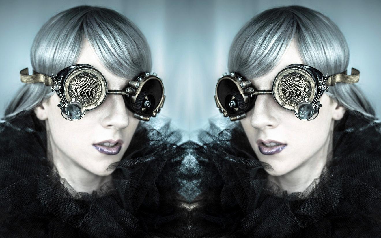 Model wearing steampunk glasses