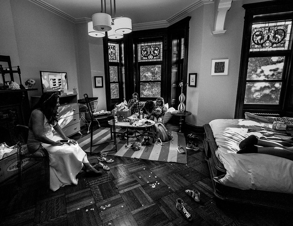 aftermath of wedding - Bride talking with bridesmaids  - Wedding photography - Black and white photography