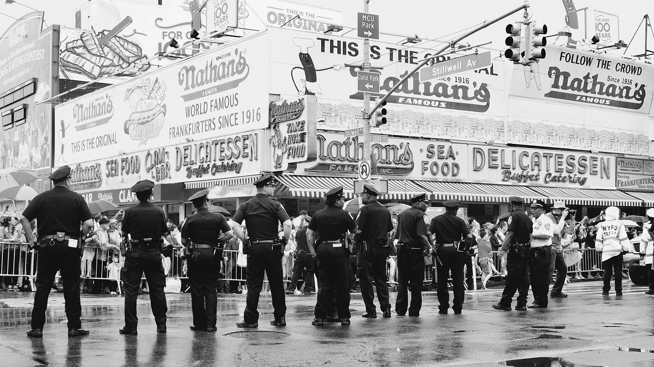Cops standing in a row in street at Coney Island - NY - Mermaid day parade - Black and white photography