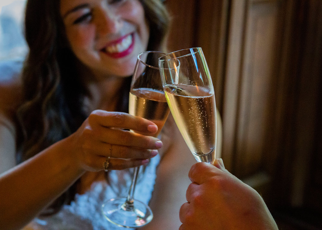 Bride making a cheers with champaign at wedding - Wedding photography