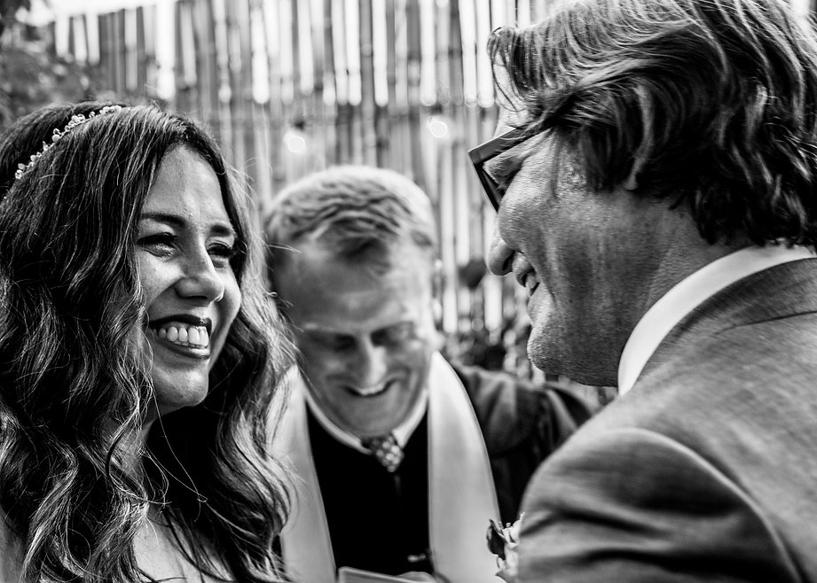 Bride and groom smiling at each other at wedding - Black and white photgraphy - Wedding photography