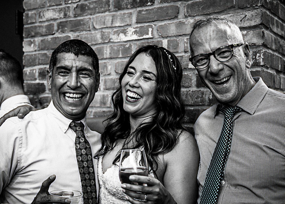 Wedding guests laughing at party  - Wedding photography - Black and white photography