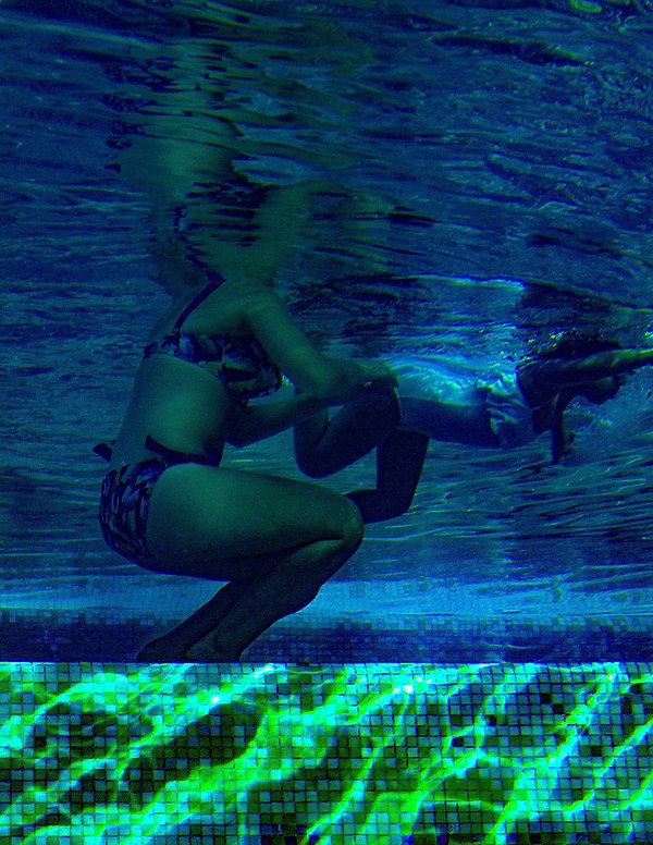 A little girl learns how to swim with her mother - Underwater - Blue and Green - Underwater photography