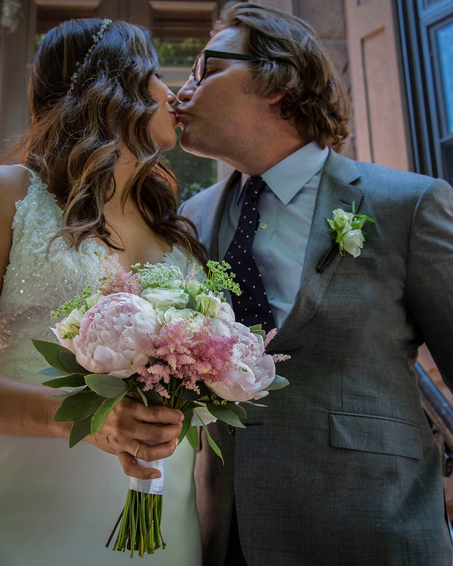 Bride and groom kissing on stoop at backyard wedding - Wedding photography