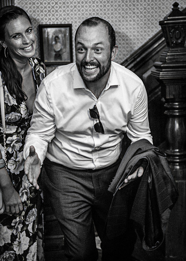 Male wedding guests having a good time at party  - Wedding photography - Black and white photography