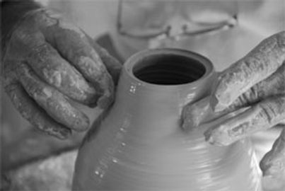 bellomo making pottery.jpg
